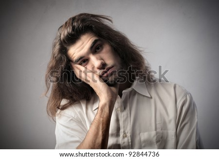Bored handsome young man - stock photo