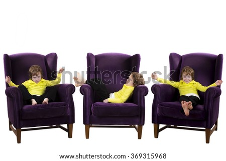 bored, happy, angry red hair boy sitting on the three purple couch