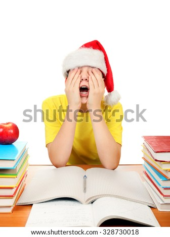 Bored Kid in Santa Hat on the School Desk Isolated on the White Background - stock photo
