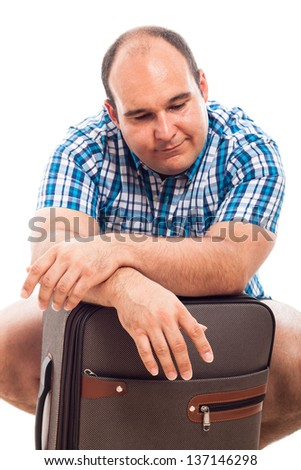 Bored traveller tourist man waiting with luggage, isolated on white background - stock photo