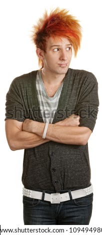 Bored white male teenager with folded arms - stock photo