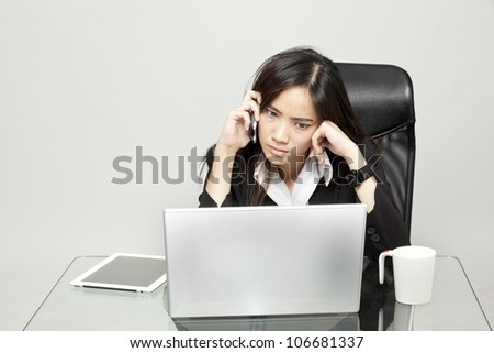 Bored woman at her desk