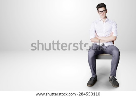 bored worker on little chair. - stock photo