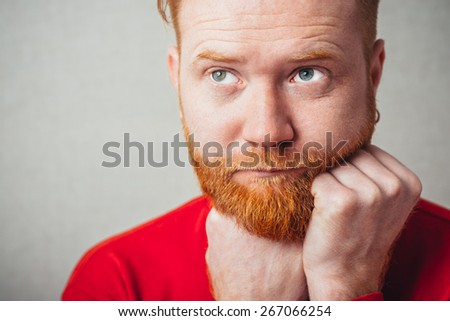 bored young redhead Man with beard