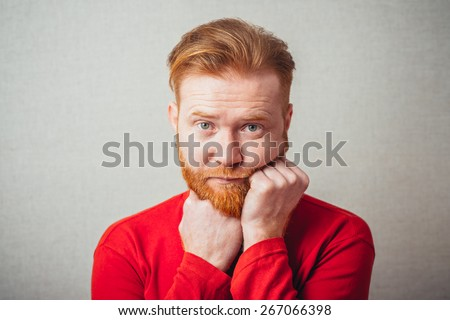 bored young redhead Man with beard - stock photo