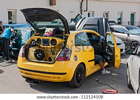 """BORGHI,RN, ITALY - AUGUST 12: Fiat Stilo with powerful speakers at rally """"Fashion tuning club"""" where the fans of tuning cars present extreme audio systems, on August 12, 2012 in Borghi, RN, Italy - stock photo"""