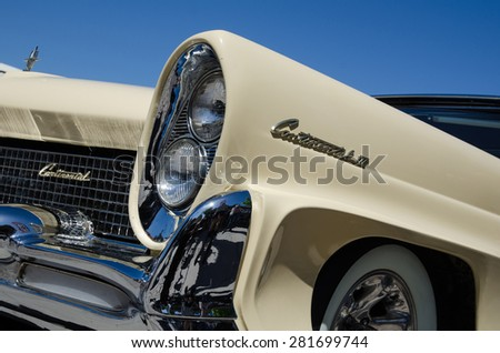 BORGHOLM, SWEDEN - MAY 23, 2015: Detail of front headlights of an old timer car Lincoln Continental, 1958 at a car meeting in Borgholm in Sweden. Photo is taken on May 23, 2015, at Borgholm, Sweden. - stock photo