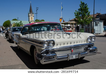 BORGHOLM, SWEDEN - MAY 23, 2015: Old timer car  Oldsmobile 98, 1958, parked at a street in the town of Borgholm in Sweden at an old timer meeting. Photo is taken on May 23, 2015, at Oland in Sweden. - stock photo
