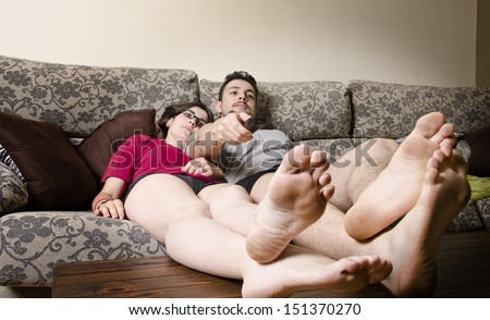 Boring Couple watching TV - stock photo