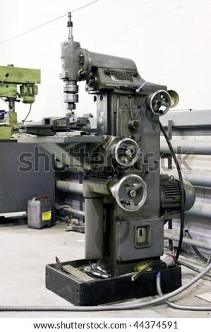 Boring machine in the workshop - stock photo