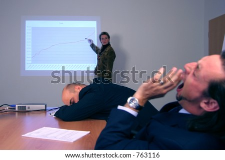 Boring presentation with sleeping attendees - stock photo