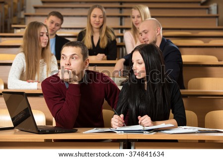 Boring students on tedious seminar in university lecture classroom