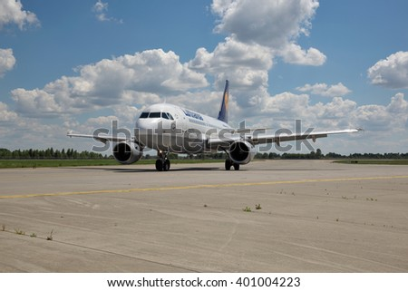 Borispol, Ukraine - July 5, 2014: Lufthansa Airbus A320 passenger plane taxiing to the terminal after landing at the airport on a sunny day