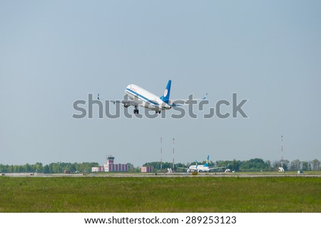BORISPOL, UKRAINE - MAY 20, 2015: Belavia Embraer 175 aircraft landing at Borispol International Airport on May 20, 2015. Editorial use only