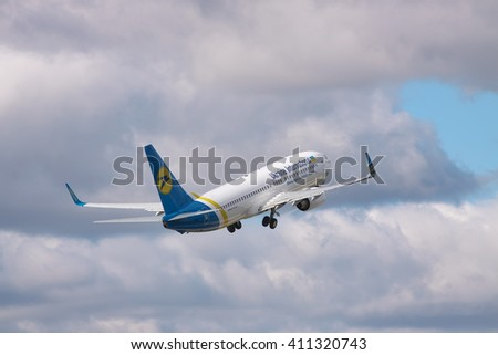 Borispol, Ukraine - October 2, 2010: Ukraine International Airlines Boeing 737 passenger plane is taking off into the cloudy sky