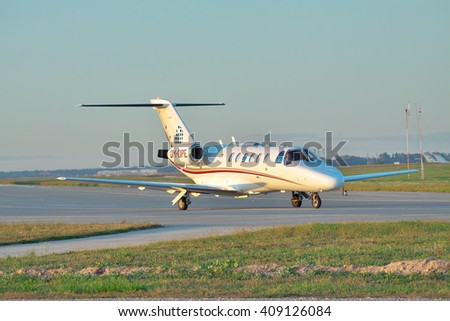 Borispol, Ukraine - Septermber 17, 2011: Cessna Citation Jet CJ2 business plane taxiing to the runway on sunset