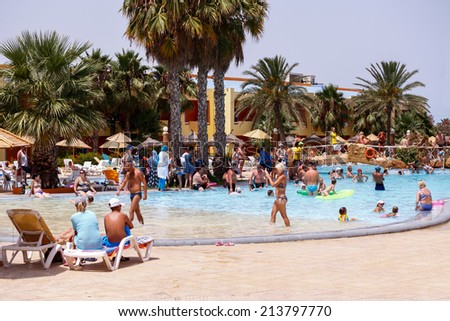 BORJ CEDRIA, TUNISIA - AUGUST 5: Tourists on holiday in an expensive hotel Carribean World in pool August 5, 2014 Borj Cedria, Tunisia. - stock photo