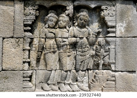 Borobudur Buddhist temple, one of the largest Buddhist churches in the world located on the Indonesian island Java. Detail on the wall - stock photo