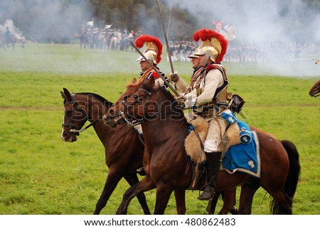BORODINO, MOSCOW REGION - SEPTEMBER 04, 2016: Reenactors dressed as Napoleonic war soldiers ride horses at Borodino battle historical reenactment in Russia. Color photo.