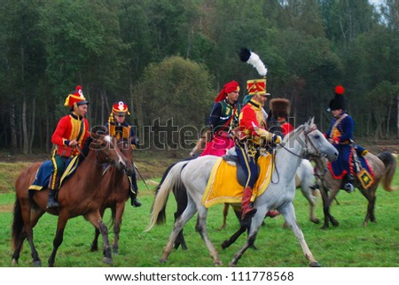 BORODINO, MOSCOW REGION - SEPTEMBER 02: Unidentified soldiers riding horses at Borodino historical reenactment battle at its 200th anniversary on September 02, 2012 in Borodino, Moscow Region, Russia.