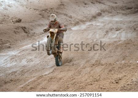 BORODINO, RUSSIA - FEBRUARY 1: A. Orekhov (2) team AMK FSO 1 Russia at the All-Russian motocross named VP Chkalov on February 1, 2015 in Borodino, motor track motorcycle club Gallaks, Russia - stock photo