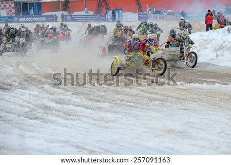 BORODINO, RUSSIA - FEBRUARY 1: Unidentified riders at the start of the All-Russian motocross named VP Chkalov on February 1, 2015 in Borodino, motor track motorcycle club Gallaks, Russia