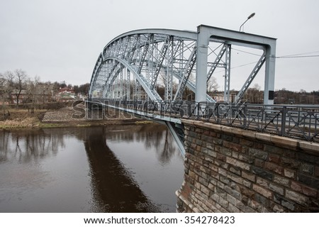Borovichi Novgorod region, Russia - December 20 2015: Pedestrian arched bridge over the Msta river, built by architect Belelyubsky in 1905.