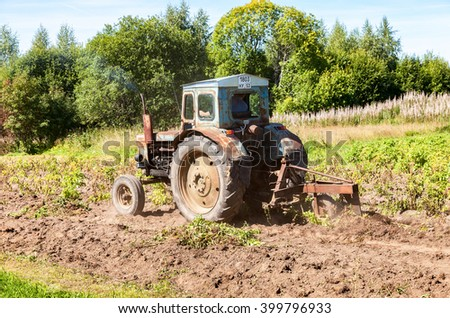 BOROVICHI, RUSSIA - AUGUST 20, 2015: Old wheeled agricultural tractor used at the potato field