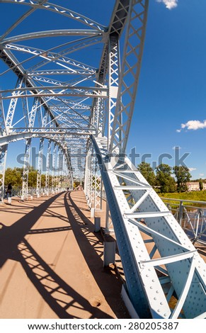BOROVICHI, RUSSIA - JULY 11, 2014: First in Russia steel arch bridge on river Msta. Was build in 1905