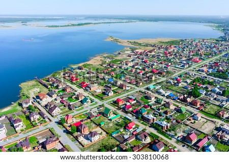 Borovskiy, Russia - May 25, 2015: Bird's eye view onto rural street near Andreevskoe lake. Tyumen region - stock photo
