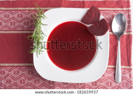 borscht soup in white plate