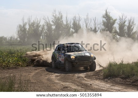 BORTALA, CHINA-JULY 17, 2016: Sports car gets over the difficult part of the route during the Silk Way rally Moscow-Beijing Dakar series on a dirt road