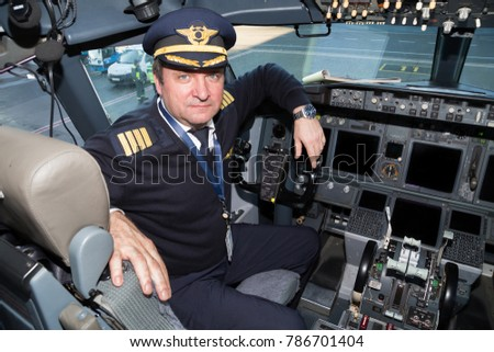Boryspil, Ukraine - DECEMBER 26, 2017: Captain pilot at work. Airplane cockpit. Aviation technology. Traveling by plane.
