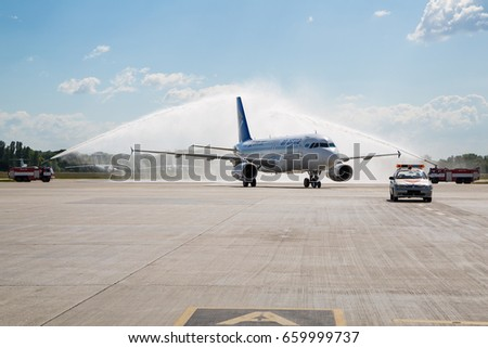 Boryspil, Ukraine - JUNE 01, 2017: Water cannon salute. Meeting airplane at the airport. Airport tradition. Air Astana Airbus A320.