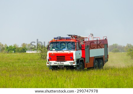 BORYSPIL, UKRAINE - MAY, 20, 2015: Fire-brigade on firetruck Tatra ride on alarm for instruction for fire suppression and mine victim assistance at Boryspil International Airport, Kiev, Ukraine - stock photo