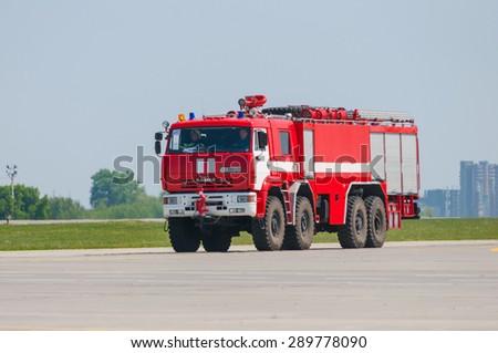 BORYSPIL, UKRAINE - MAY, 20, 2015: Modern red firetruck Kamaz ride on call fire suppression and mine victim assistance at Boryspil International Airport, Kiev, Ukraine.  - stock photo