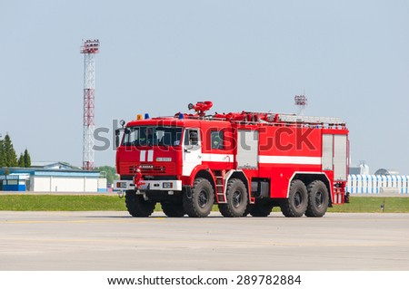 BORYSPIL, UKRAINE - MAY, 20, 2015: Red firetruck Kamaz ride on alarm for instruction for fire suppression and mine victim assistance at Boryspil International Airport, Kiev, Ukraine.  - stock photo