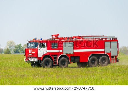 BORYSPIL, UKRAINE - MAY, 20, 2015: Red firetruck Kamaz ride on alarm for instruction for fire suppression and mine victim assistance at Boryspil International Airport, Kiev, Ukraine - stock photo