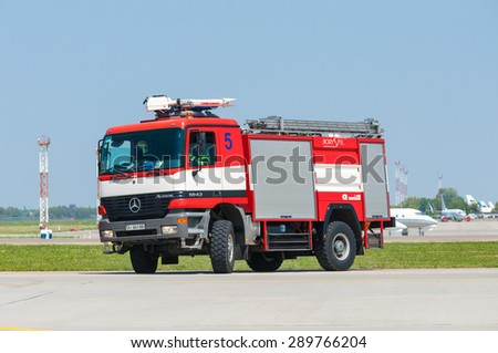 BORYSPIL, UKRAINE - MAY, 20, 2015: Red firetruck Mercedes Benz ride on call fire suppression and mine victim assistance at Boryspil International Airport, Kiev, Ukraine.  - stock photo