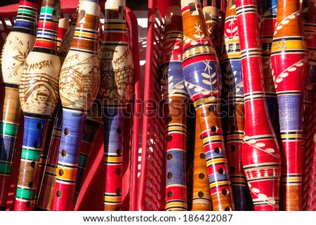 BOSNIA AND HERZEGOVINA, MOSTAR - SEPTEMBER 17, 2008: Traditional handmade  reed-pipe flutes in a gift shop in Mostar, Bosnia and Herzegovina. Mostar is the fifth-largest city in the country.