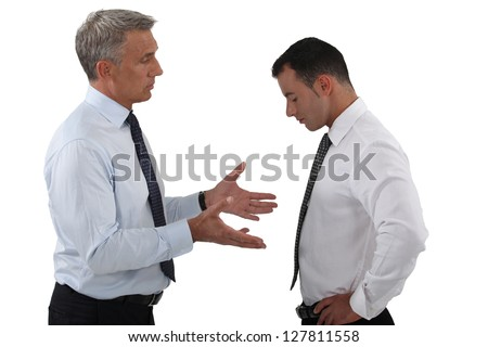 Boss and employee having a serious discussion - stock photo
