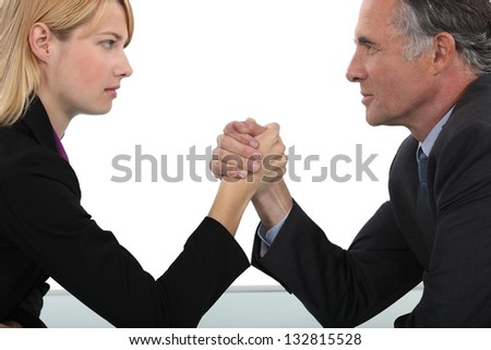 Boss and employee having an arm wrestle - stock photo