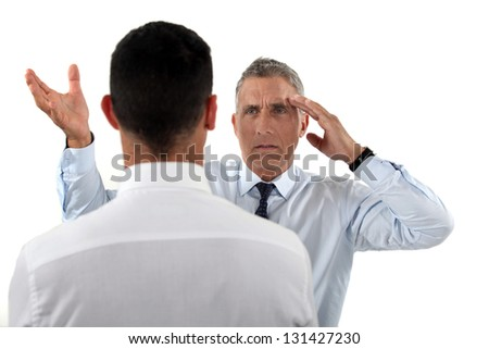 Boss angry at his employee - stock photo