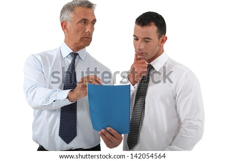 Boss delegating work to employee - stock photo