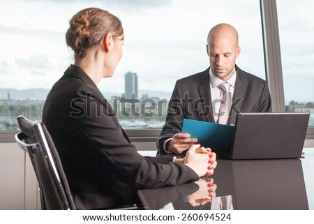 Boss evaluates a female worker  - stock photo