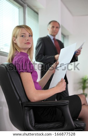 Boss practicing presentation in front of PA - stock photo