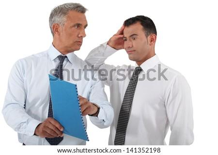 Boss reprimanding his employee - stock photo