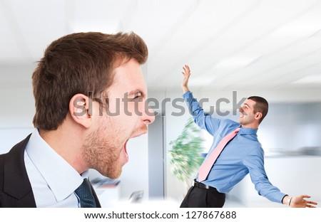 Boss shouting at an employee - stock photo