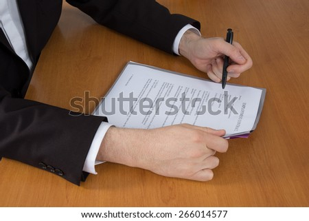 Boss signing a business contract