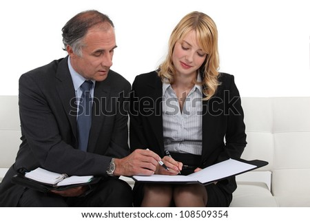 Boss signing paperwork - stock photo